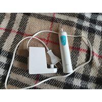 Электрическая зубная щётка Braun