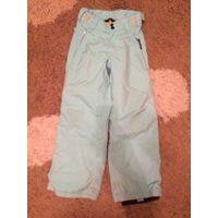 Фирменные лыжные штаны унисекс на рост 128 см. Длина 80см, ПОталии 31см, ПОбедер44см. Хорошее состояние. Голубого цвета.