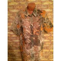 Красивая легкая рубашка на 52-54 размер. Смотрится очень интересно. Длина 72 см, ПОгруди 63 см.