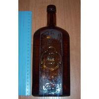 Бутылка немецкая со слоном CARL MAMPE BERLIN ОРИГИНАЛ С ИСКРИВЛЁНЫМ ГОРЛЫШКОМ КОРИЧНЕВОГО ЦВЕТА.