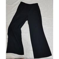 Школьные черные брюки на девочку подростка