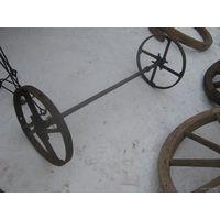 Два стальных колеса с осью