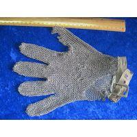 Перчатка кольчужная для чистки рыбы.