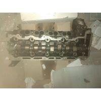 Головка блока цилиндров двигателя (ГБЦ) б/у для Opel Omega B, универсал, 2,2 дизель, 2002 год