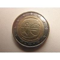 2 евро 2009 Нидерланды 10-летие монетарной политики ЕС и введения евро (юбилейная)