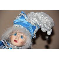 Коллекционный Арлекин -музыкальная подвижная кукла