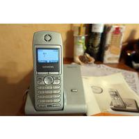 Телефон Siemens Gigaset S440. Рабочий, быстро садится батарея, иногда подглючивает.