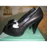 Кожаные туфли с открытыми носиками