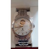 Швейцарские механические часы фирмы Carl F. Bucherer с позолоченным механизмом и золотыми стрелками, новые, гарантия. Сапфир. Автоподзавод.