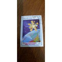 Лаос 1986. 25 летняя годовщина первого полета в космос. Марка из серии