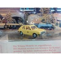 """Модель автомобиля VW Golf  """"почтовая служба Германии"""" масштаб 1/87 HO"""