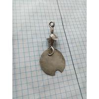 Старинное серебряное украшение.