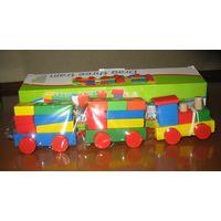 Деревянный логический конструктор-паровозик Состоит из локомотика и двух прицепных вагонов. Игрушка многофункциональная.  Во-первых, это настоящий паровозик, который можно катать.  Во-вторых, его можн