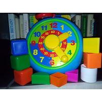 Игрушка развивающая Часы с фигурками