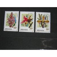 Марки - флора Руанда 1976 - цветы орхидеи