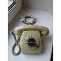 Телефон дисковый.