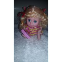 Кукла поющая нова