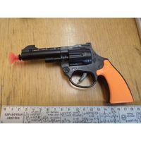 Пистолет пластмассовый игрушечный.
